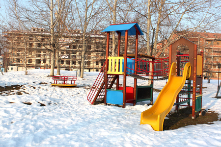 snowy playground in an urban park in Piedmont Italy photo