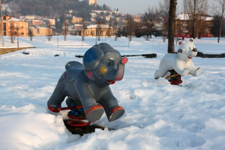 land slide: snowy playground in an urban park in Piedmont Italy