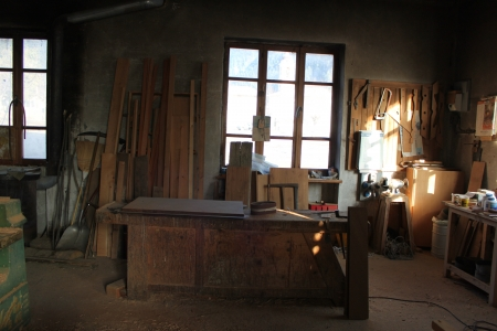 A work bench with old carpentry tools photo