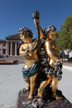 gilt: angel statues of gilt boy in Marseille