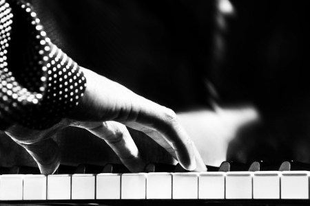 keyboard player: A black man playing piano closeup