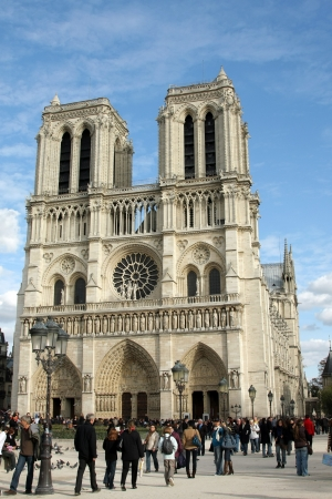 essentially: PARIS - JULY 20   Notre Dame Cathedral on July 20, 2010 in Paris  The cathedral was essentially completed by 1345 and is very popular travel destination in France