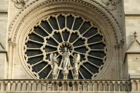 Stained facade window of Notre Dame in Paris, France photo