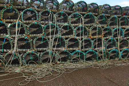 lobster pot: Lobster or crayfish pots stacked on fishing boat