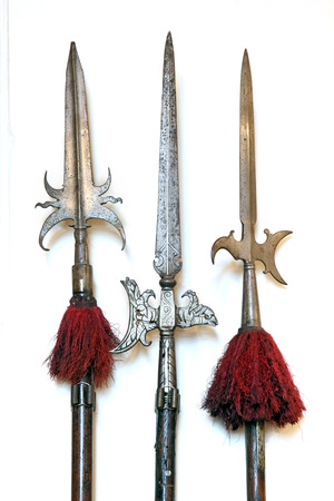Weapon set  A large set of medieval weaponry  Spears, halberds and battle axes  Isolated on white background photo