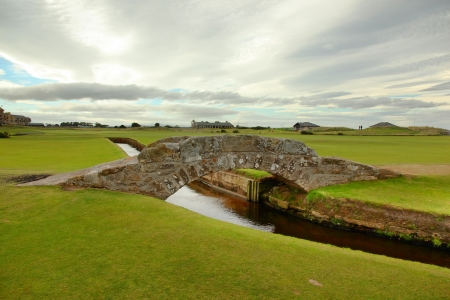 golf flag: The famous Swilcan bridge on St Andrew Old Course Stock Photo