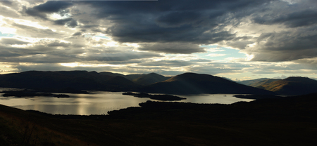 Loch Lomond is a freshwater Scottish loch  It is the largest inland stretch of water in Great Britain by surface area  The loch contains many islands photo