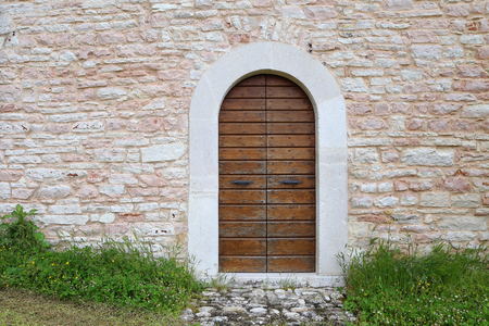 An image of an old door in Altino, Ascoli Piceno - Italy photo