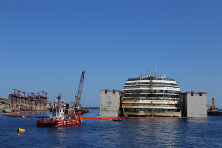 concordia: GIGLIO ISLAND, ITALY - JULY 19, 2014  Front view of the wreck of Costa Concordia on July 19, 2014 in Giglio Island, Italy