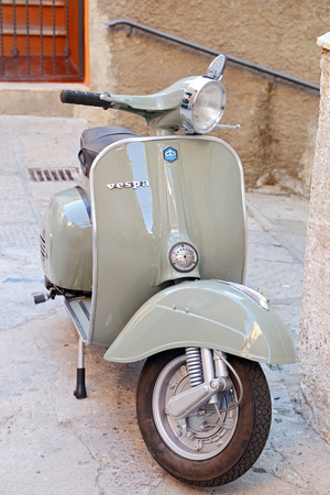 PORTO SANTO STEFANO, ITALY - JULY 18, 2014  classic Vespa is one of the products of the industrial design world