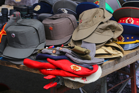 checkpoint: Sale stand of Soviet and DDR militaria near Checkpoint Charlie in Berlin, Germany.