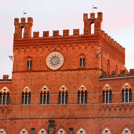 siena italy: Campo Square with Public Building at sunset, Siena, Italy