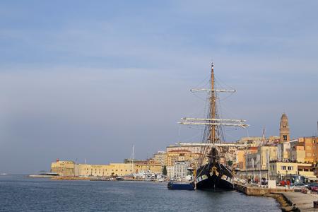 GAETA, ITALY � � �,�� � � JUNE 25, 2016: The three masted Palinuro, a historic Italian Navy training barquentine, moored in the port Gaeta.