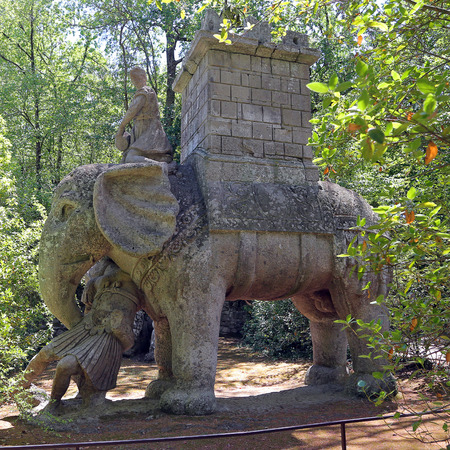 BOMARZO, ITALY - 2 JULY 2017 - The battle elephant statue, with a Roman centurion trapped in the proboscis, is probably the tribute of Bomarzos lord to Annibales businesses.