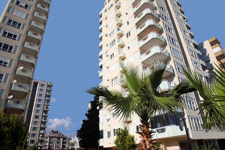 Apartment Buildings Against Blue Sky. Stock Photo - 26008118