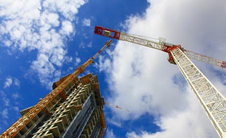 Building Under Construction Against Cloudy Sky. photo