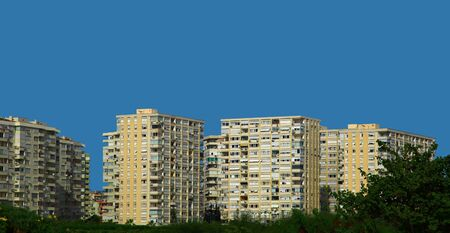 Apartment Buildings Against Blue Sky. photo