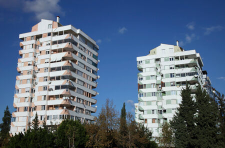 Apartment Buildings Against Blue Sky.