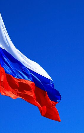 Flag of the Russia against the blue sky.