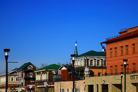 IRKUTSK, RUSSIA - 01 NOVEMBER, 2014: Street with typical Russian log cabins located in the Irkutsk Sloboda (130 Quarter). Editöryel