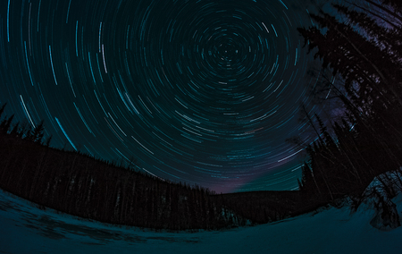 polaris: These star trails around the north star Polaris also cross some faint pink aurora borealis over the Chena River in Alaska