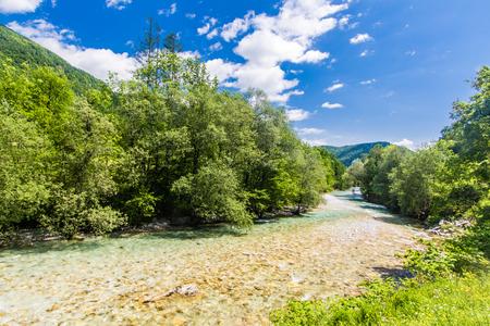 Springtime photo of the crystal clear Tolminka River running down toward Tolmin, Slovenia Standard-Bild