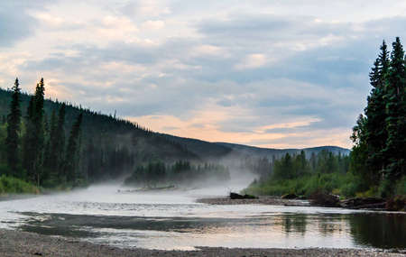Mist rises above the water on the Chena River, Alaska