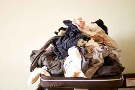Overflowing laundry at home. COpy space. Messy real life. Chores Stockfoto