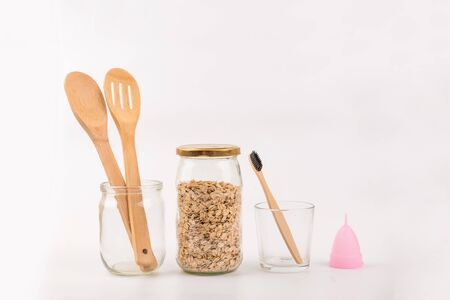 Mason jar, bamboo cutlery and toothbrush, menstrual cup. Zero waste kit. Eco friendly
