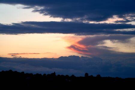 Fiery orange and blue sunset sky. Beautiful sky. Background nature. Life Stock Photo
