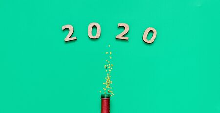 Champagne bottle and golden strars glitter on green bavkground. banner for christmas, birthday