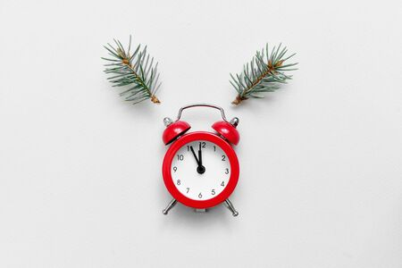 Flat lay composition with alarm clock and pine tree ears as deer. Christmas countdown. New year eve
