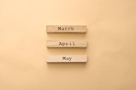 Wooden calendar spring months on wooden cubes. Top view Flat Lay Minimal