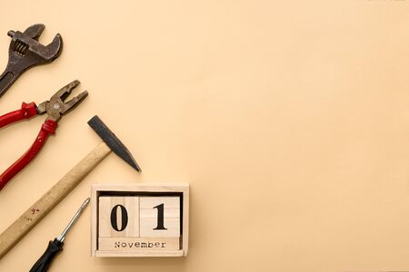 November 1st. Day 1 of November set on wooden calendar on on beige background