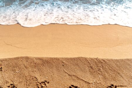Minimal composition of sand and sea water. Aerial view. Copy space. Background for summer travel Foto de archivo
