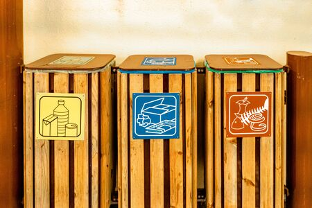 Waste bins for recycling. Wooden background. Climate change.