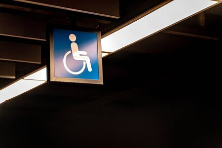 Wheelchair sign in subway station. Disabled modern life. Copy sapce Stock Photo