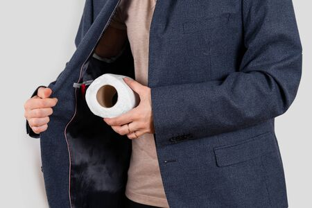 Close up of toilet paper black market seller. Panic buying during pandemic Covid-19. Home quarantine
