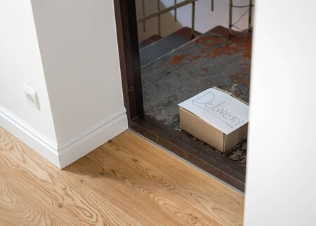 Delivery box on the floor near the door. Contactless delivery during quarantine covid-19