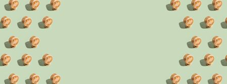 Minimal summer background of mini fan pattern on green background. Isometric trendy style with shadows