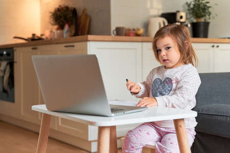 toddler girl e-learning at home. preschool online class. Stock fotó