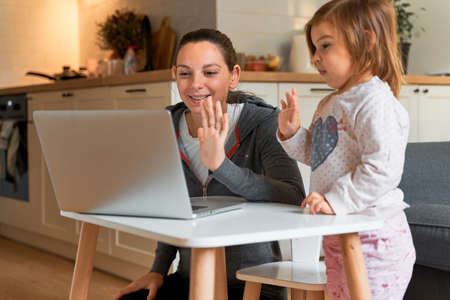 Mother and child at home. Video chat. Family doctor online. Social distance. Distance learning, home learning.