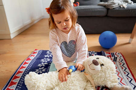 Beautiful with child play doctor at home. Child play doctor for healthcare design. Health care. Stock fotó