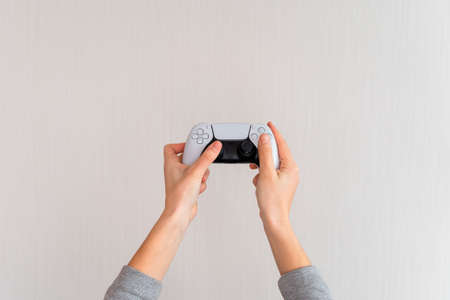 Videogame console wireless gamepad. white lifestyle background. Minimal style. Modern leisure at home.