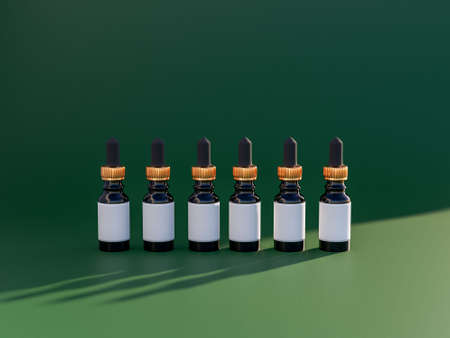 Row of luxury essential oils bottles with empty label. 3d render in trendy emerald and gold style colours. Refillable packaging solutions. Banco de Imagens