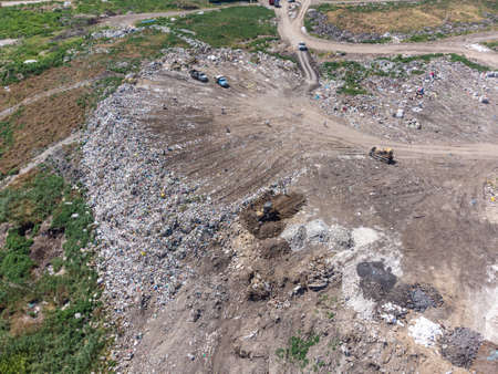 Aerial view of huge rubbish dump. Trash and garbage landfill. Ecology problem, nature pollution. Consumerism economy cons.