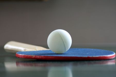 a ping pong ball and paddle