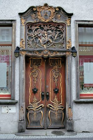 Richly decorated old door in baroque style. Poland, Gdansk. Stock Photo - 7750556