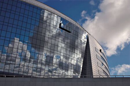 Sky reflection in modern building windows.   photo