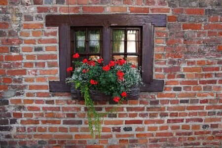 Small window of old medieval house. photo